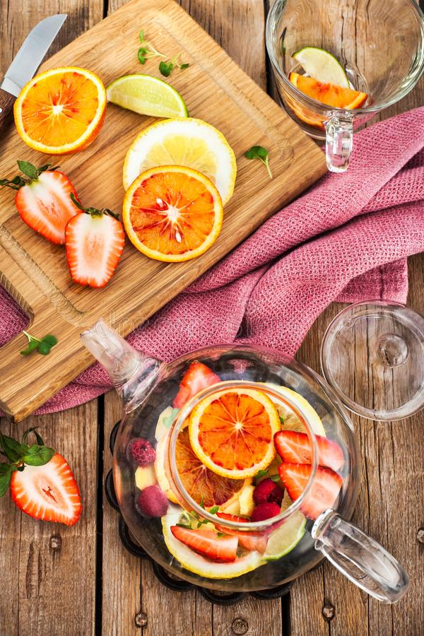 Fruit red tea with oranges and berries on table, top view. Fruit red tea with oranges and berries on wooden table, top view stock photo