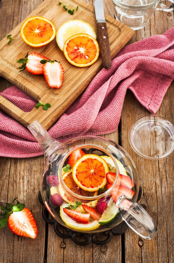 Fruit red tea with oranges and berries on wooden table. Top view royalty free stock photography