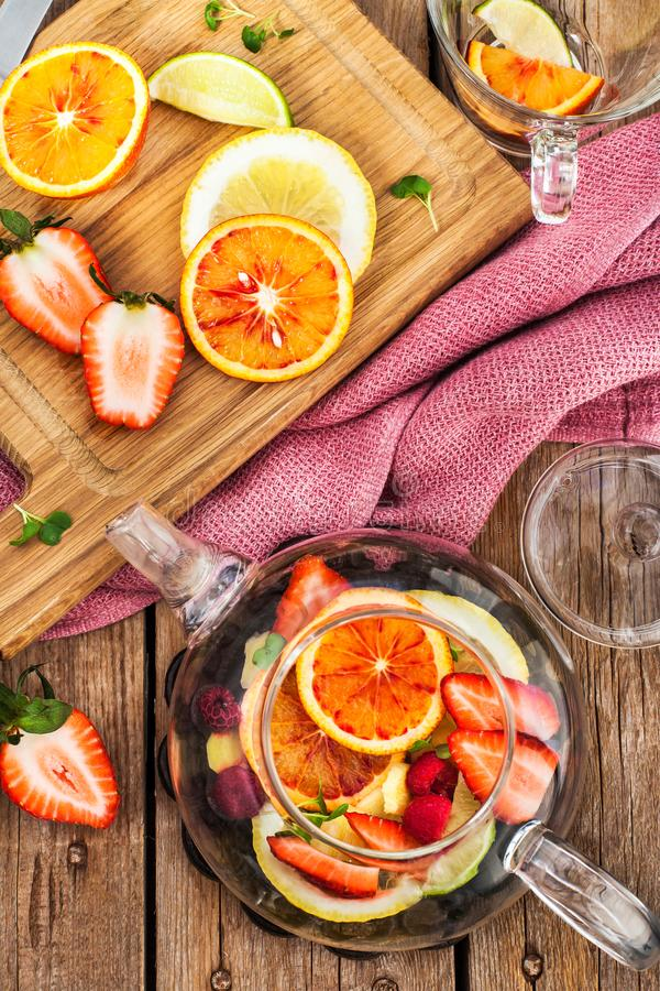 Fruit red tea with oranges and berries on wooden table. Top view royalty free stock photos