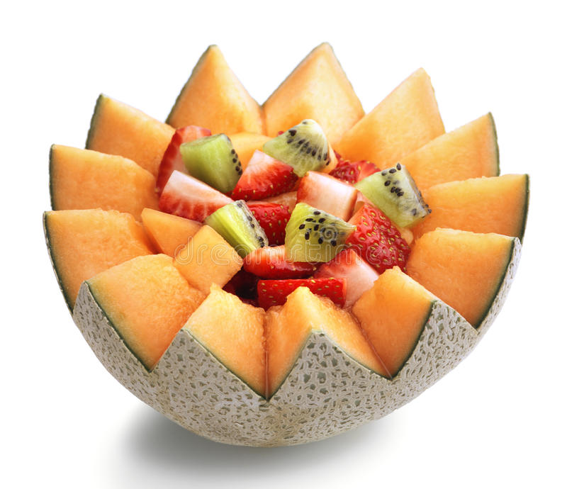 Fruit salad. Fresh Fruit Salad in Cantaloupe Bowl stock photo