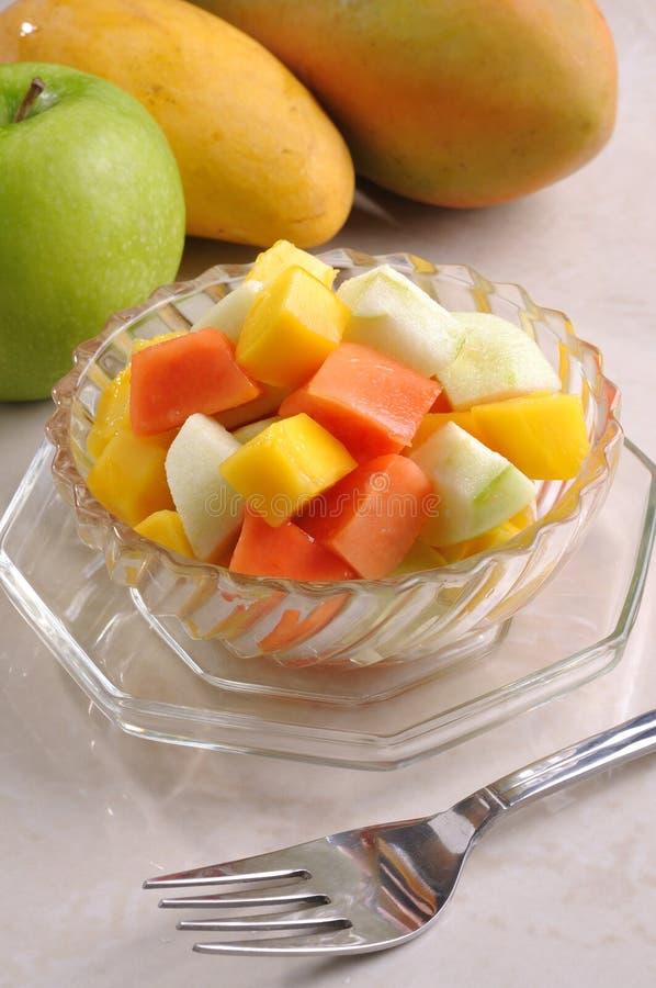 Fruit salad. With apple mango papaya royalty free stock images