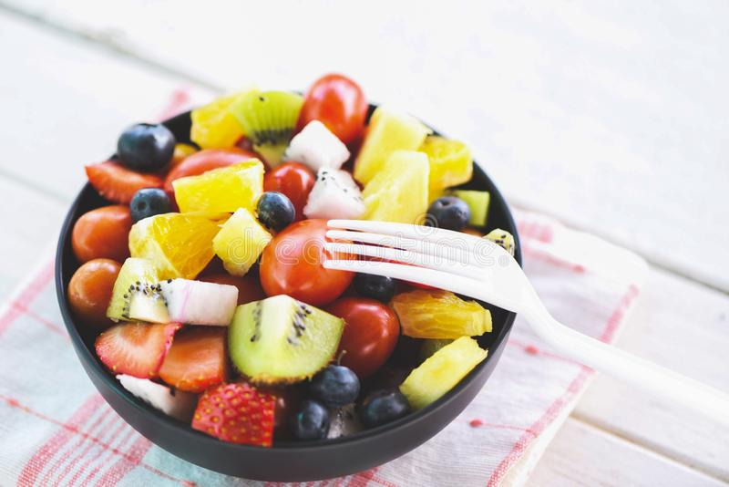 Fruit salad bowl fresh summer fruits and vegetables healthy organic food strawberries orange kiwi blueberries dragon fruit royalty free stock image