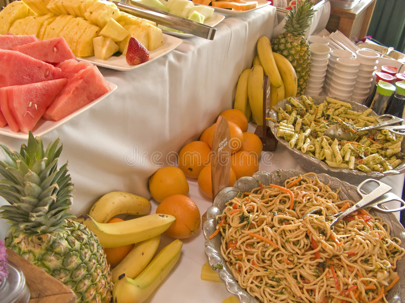 Fruit and Salad Buffet Table. Buffet Table with fruit and noodle, pasta salad royalty free stock photography