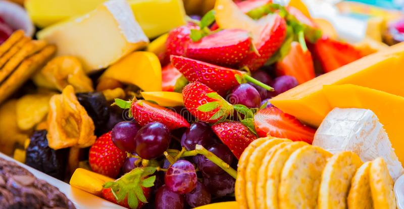 Fruit Salad and cheese board at Spring Festival. Picnic event royalty free stock photo