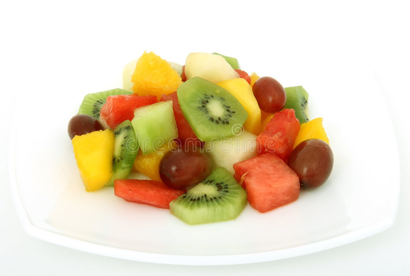 Fruit salad coctail on a plate stock images