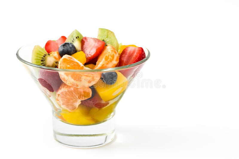 Fruit salad in crystal bowl isolated royalty free stock photography