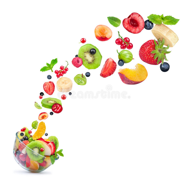 Fruit salad ingredients in the air in a glass bowl royalty free stock image