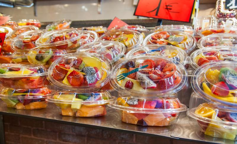 fruit salad in plasic boxex at La Boqueria market in Barcelona stock photo