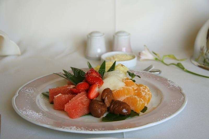 Fruit salad on a plate royalty free stock photo
