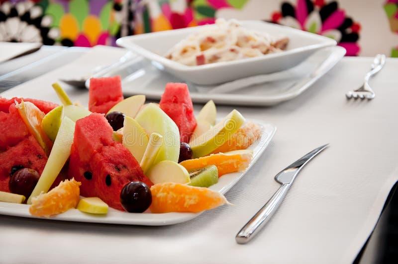Download Fruit Salad And Spaghetti Carbonara Royalty Free Stock Image - Image: 15182506
