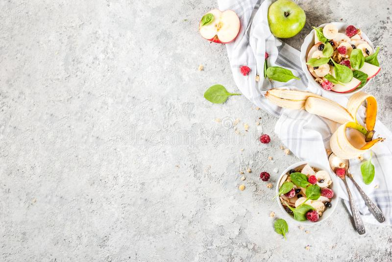 Fruit salad with spinach and granola royalty free stock image