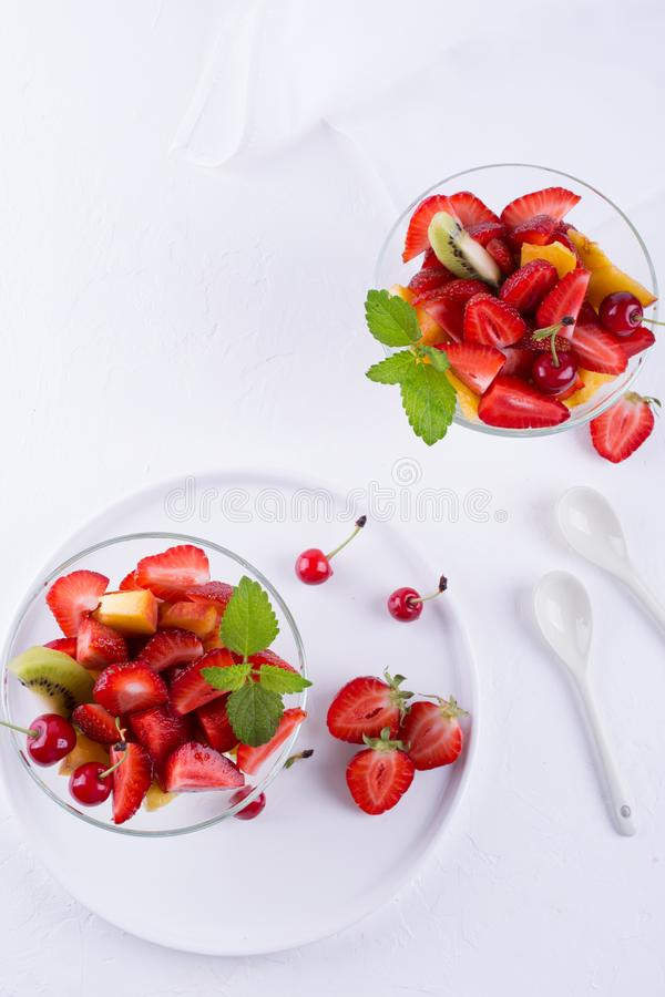 Fruit salad of strawberries, kiwis and apricots. Fresh and tasty snack . royalty free stock images