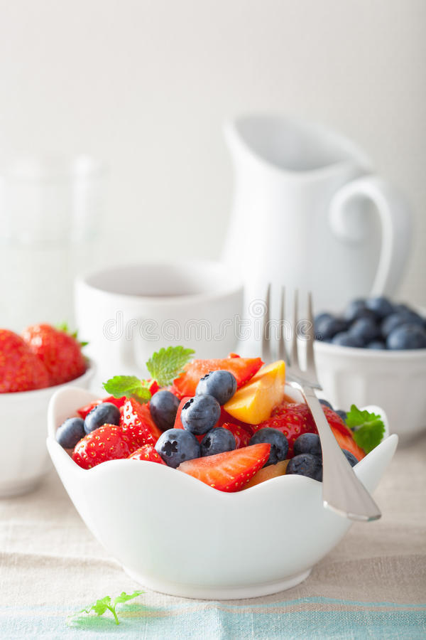 Fruit salad with strawberry blueberry apricot for breakfast royalty free stock image