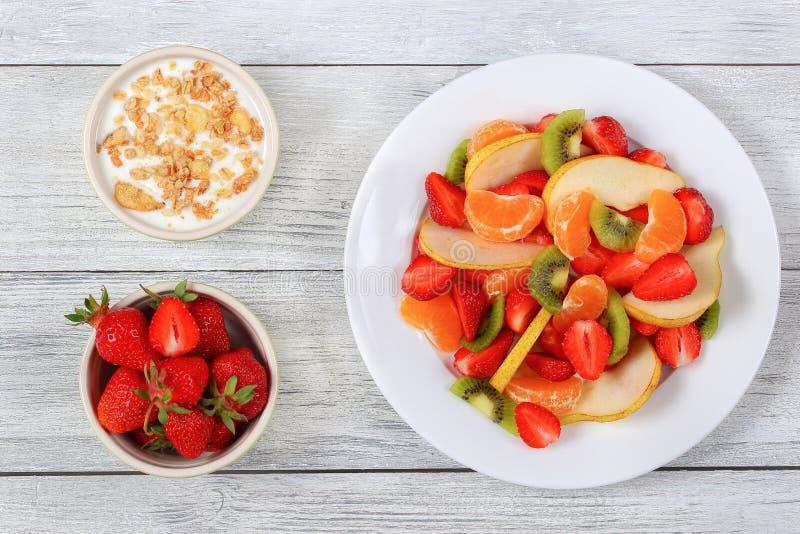 Fruit salad and yogurt with muesli royalty free stock image