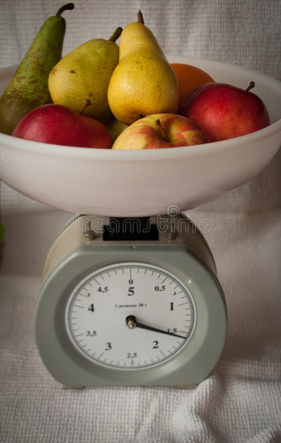 Fruit on the scales apples royalty free stock photo