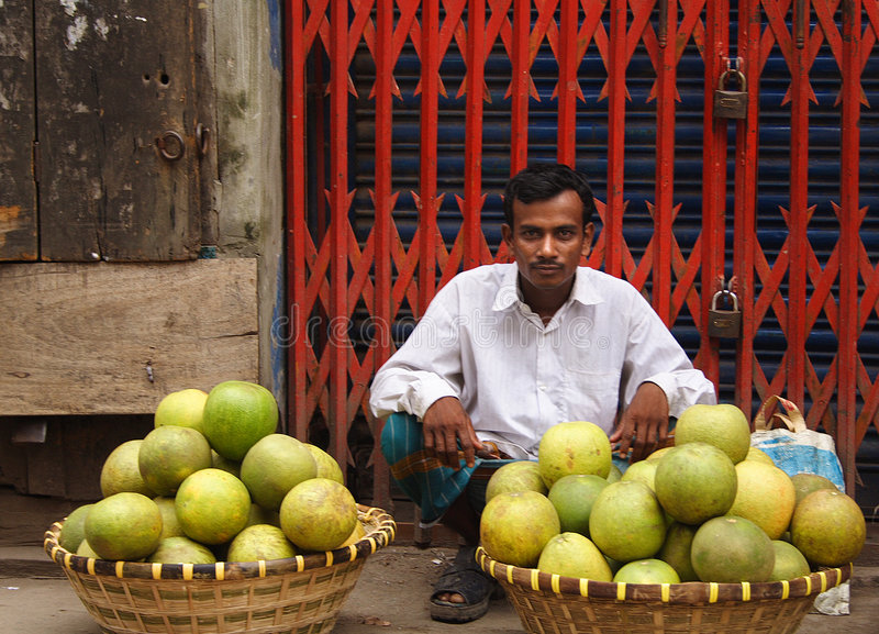 Fruit seller in Old Dhaka, Bangladesh. Man Sells fruit on the streets of Old Dhaka, Bangladesh royalty free stock photo