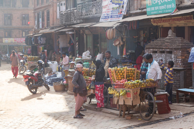 Fruit seller in the streets of Bhaktapur, Nepal stock photography