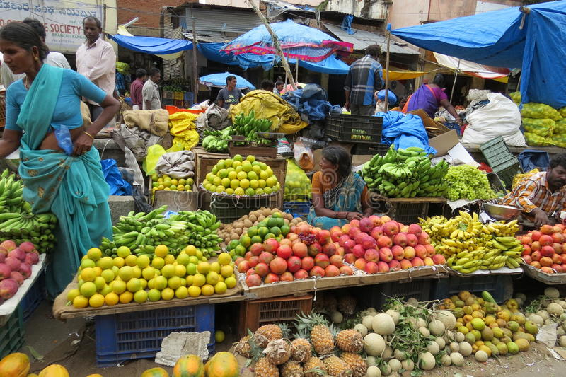 Fruit sellers in KR market,Bangalore. Fruits galore on display in KR market royalty free stock image