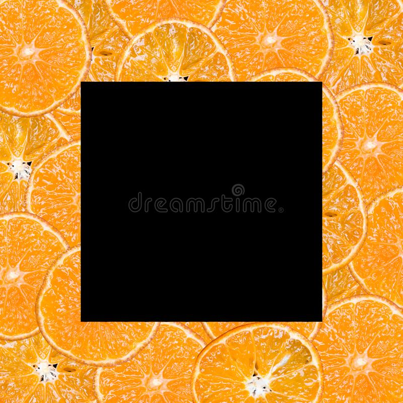 Fruit slices on a black background royalty free stock photos