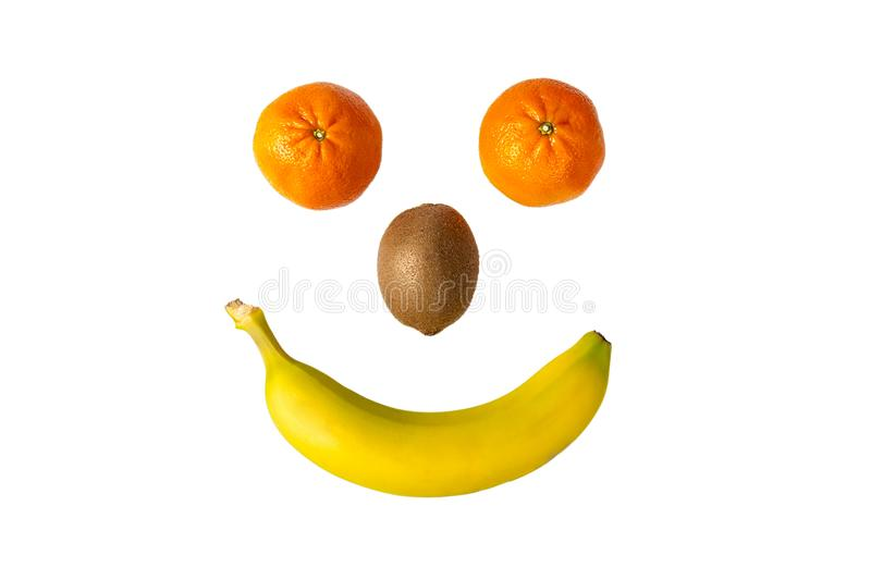 Fruit Smiley or Emoji, Isolated On White. A fruit smiley, emoji made of 2 tangerine, a kiwi and a banana, isolated on white stock images