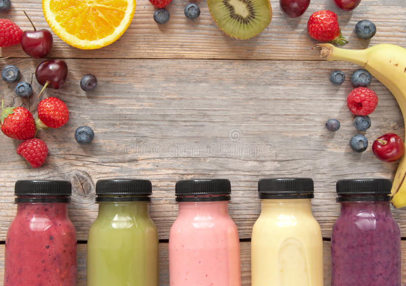 Fruit smoothies background with space stock photo