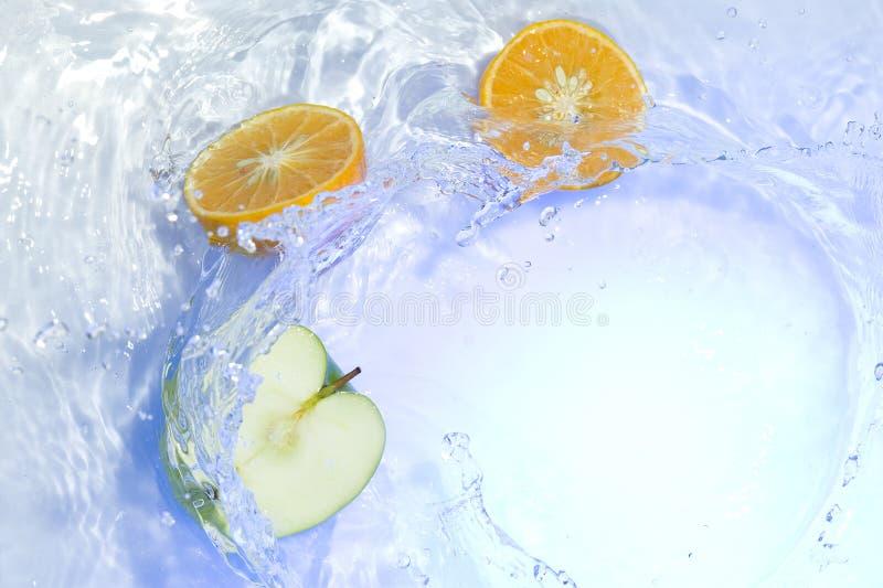 Fruit with splashing water stock image