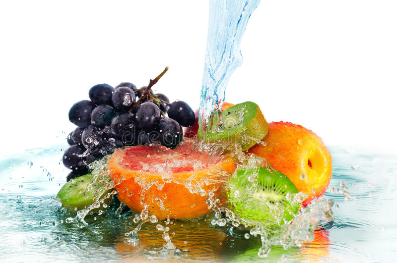 Fruit in a spray of water stock photos