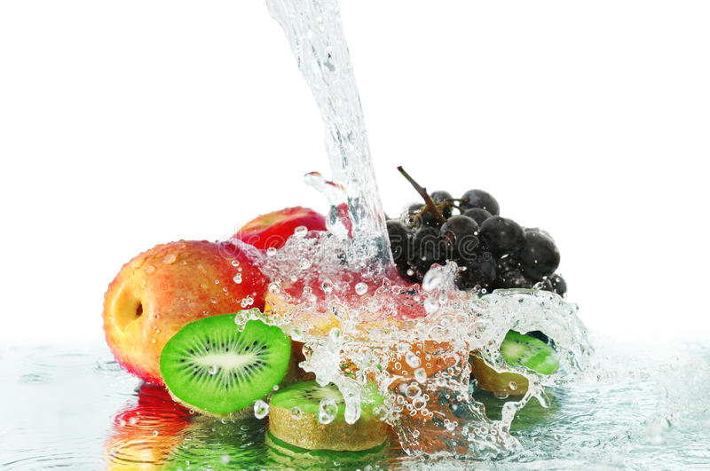 Fruit in a spray of water. On a white background stock photos