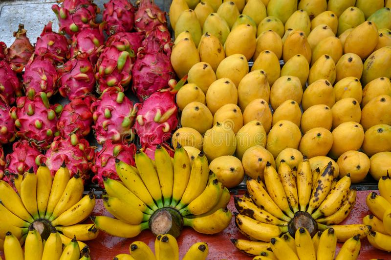 Fruit stable with mangos, dragon fruits and bananas on rainy day in Asia stock photo