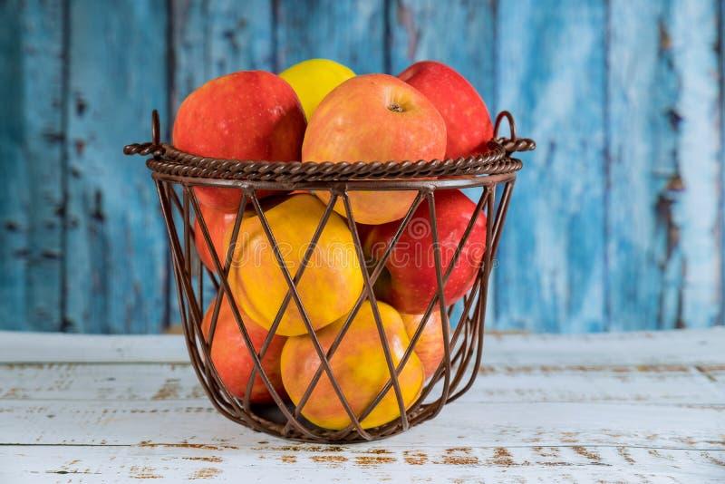 Fruit steel basket with red, orange apples. Fruit steel basket full of red, orange apples, agriculture, food, healthy, harvest, fresh, ripe, background, organic stock photo