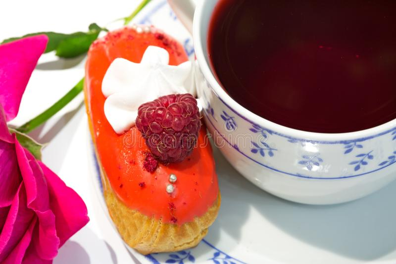 Fruit strawberry eclair cake with hibiscus tea Sudan rose tea royalty free stock images