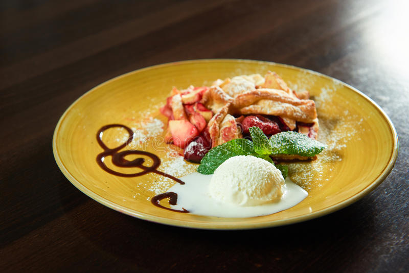 Fruit strudel with a scoop of ice cream royalty free stock photos