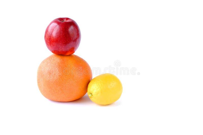 Fruit sur un fond blanc Apple, pamplemousse, citron image stock
