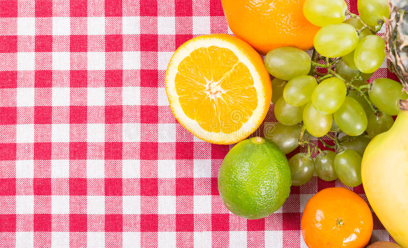 Fruit on tablecloth textile royalty free stock photography