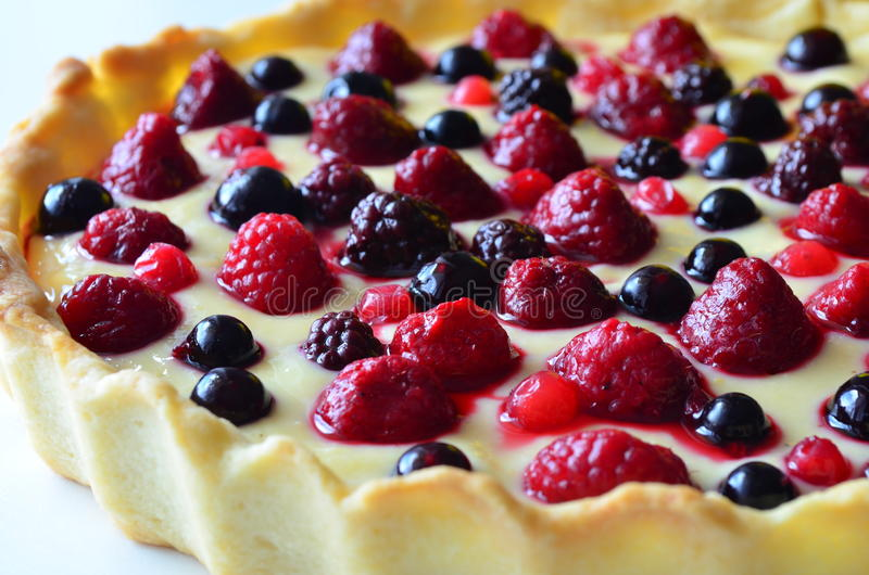 Fruit tart desert with raspberry, blackberry and blueberry royalty free stock photography
