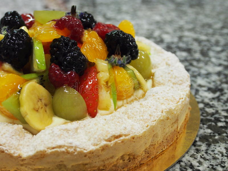 Mixed fruit tart, marble surface royalty free stock photo