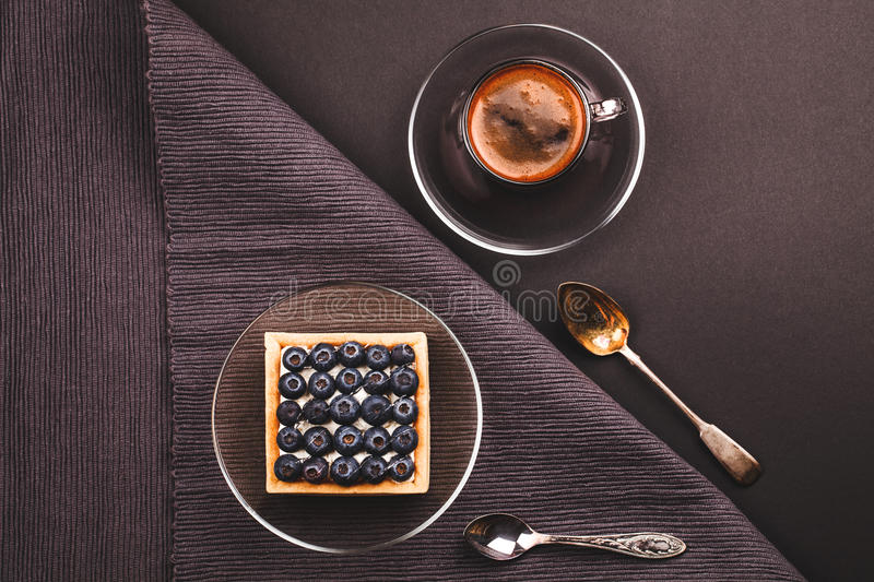Fruit tartlet with cup of coffee royalty free stock photos