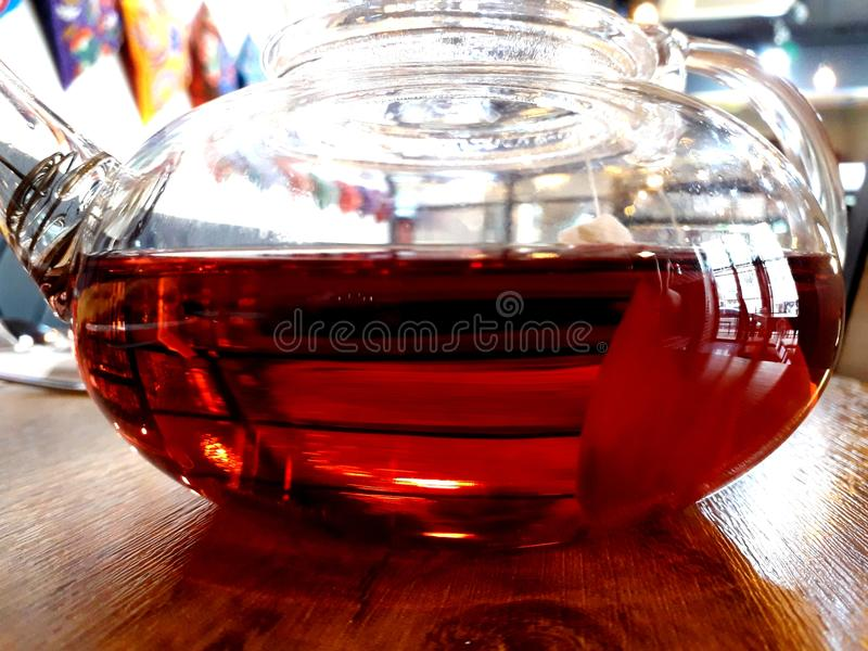 Fruit tea in glass teapot royalty free stock images