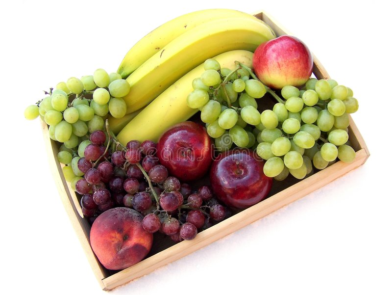 Fruit on the Tray. Different fruit on the wooden tray on white background stock photo