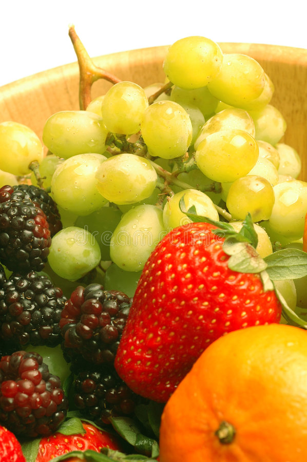 Fruit variety grapes strawberry raspberry stock photos