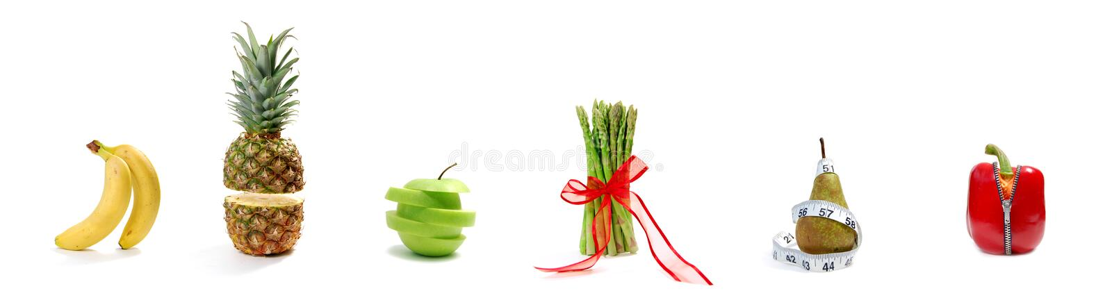 Fruit and vegetable parade. Row of fruits and vegetables including'standing' bananas, a pepper zip, and a floating cut pineapple; illustrating concepts relating stock image