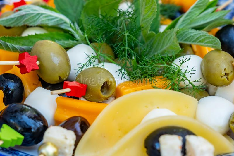 Fruit and vegetable salads with olive, cheese and other ingredients royalty free stock photo