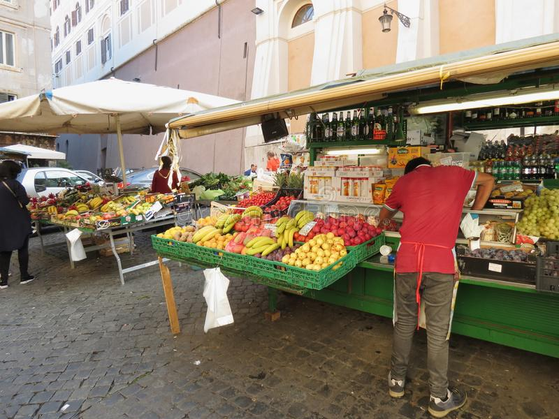 Fruit and vegetable shop counter in Rome stock photography