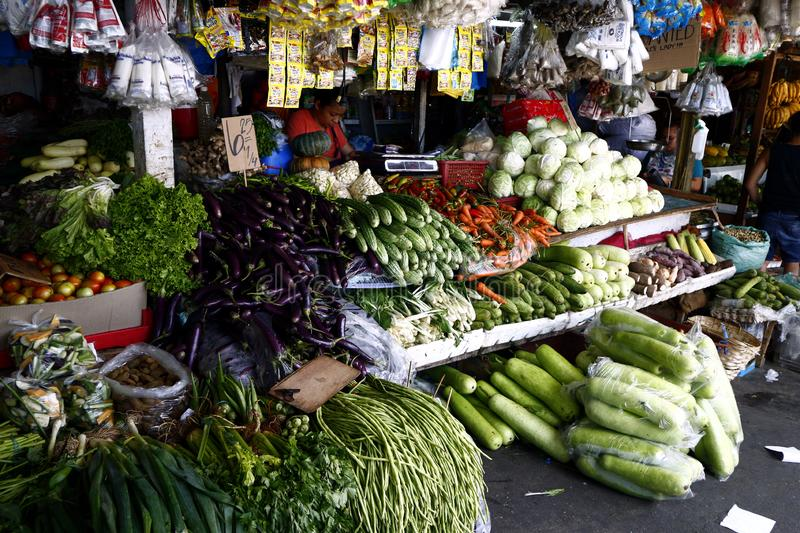 Fruit and vegetable stalls in a public market royalty free stock photo