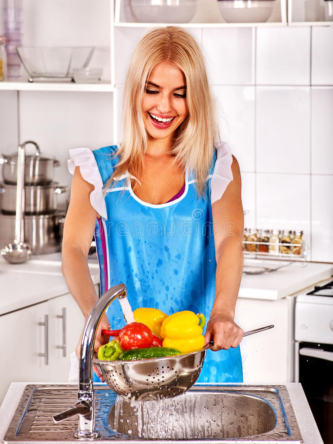 Fruit and vegetable wash of woman on kitchen home. royalty free stock photo