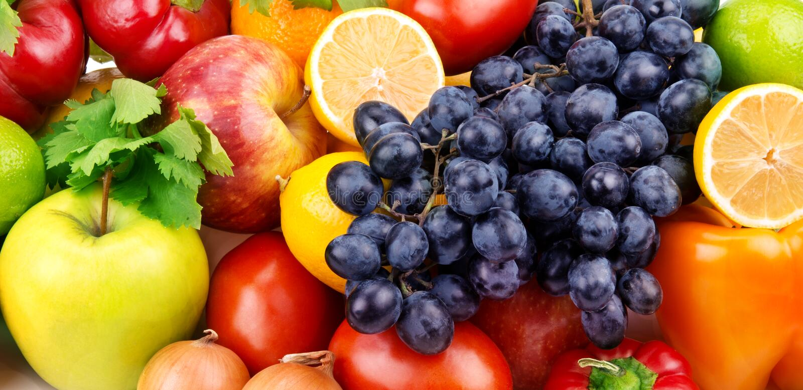 Fruit and vegetables. Background of bright fruit and vegetables royalty free stock photography