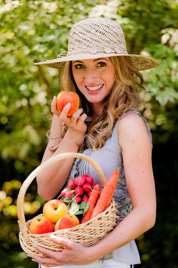 Fruit and vegetables in the basket with his wife royalty free stock photos