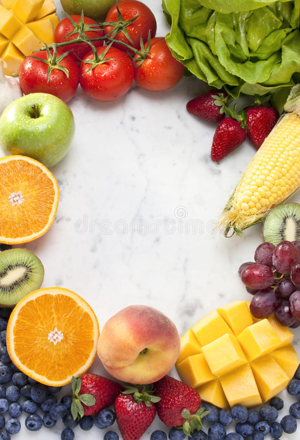 Fruit Vegetables Frame Background. Fruit and vegetables formed in a frame pattern on white marble background stock photos