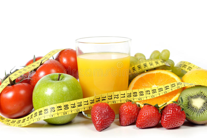 Fruit , vegetables and orange juice in measure tape stock photos