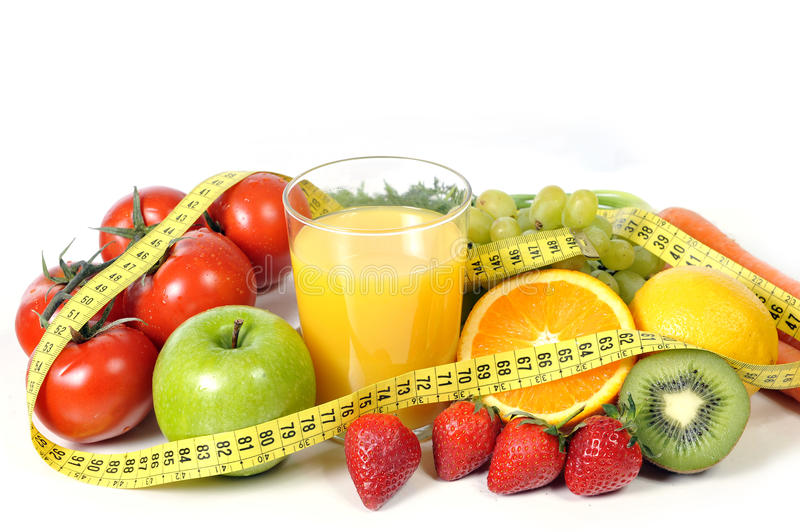 Fruit , vegetables and orange juice in measure tape stock photo